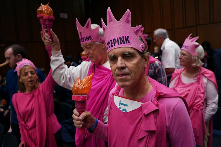 Members of Code Pink for Peace protest before the start of a hearing where U.S. Attorney General Jeff Sessions will testify to the Senate Judiciary Committee in the Hart Senate Office Building on Capitol Hill on Oct. 18, 2017. Committee members questioned Sessions about conversations he had with President Donald Trump about the firing of former FBI Director James Comey, the Deferred Action for Childhood Arrivals (DACA) policy, the ongoing investigation about Russian interference in the 2016 presidential election and other subjects.