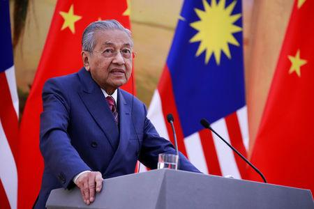 FILE PHOTO: Malaysia's Prime Minister Mahathir Mohamad speaks during a news conference with China's Premier Li Keqiang at the Great Hall of the People in Beijing, China, August, 20, 2018. How Hwee Young/Pool via REUTERS