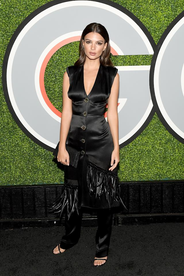 <p>The model worked a black satin look with fringing. <em>[Photo: Getty]</em> </p>