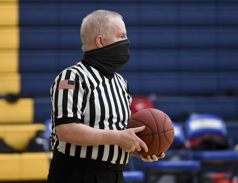 A Pennsylvania Interscholastic Athletic Association basketball official referees a game. (Ben Hasty/MediaNews Group/Reading Eagle via Getty Images)