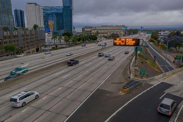 PHOTO: An aerial view shows a sign imploring drivers to not speed while morning traffic gradually increases on the Interstate 110 freeway as the coronavirus pandemic continues, in Los Angeles, May 18, 2020. (David Mcnew/Getty Images)