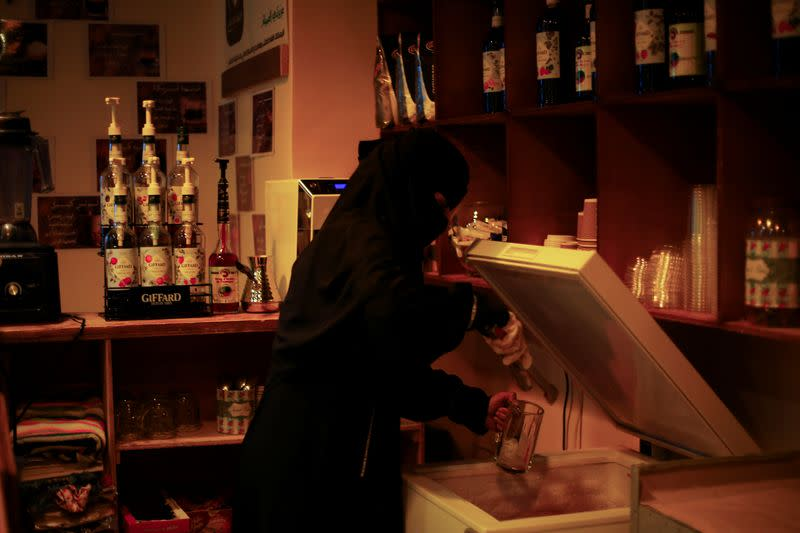 Um Feras, the owner of the only all-female internet cafe in Yemen's Marib province prepares a beverage at her cafe in Marib