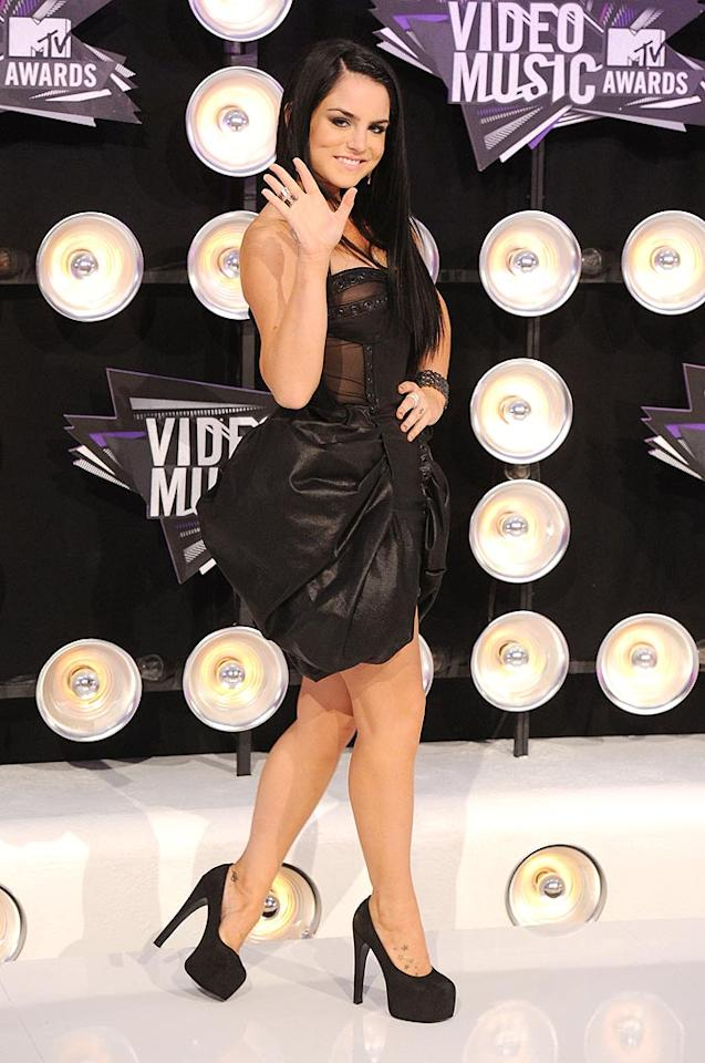 "Singer JoJo, 20, donned a sheer strapless black dress -- that looked a little like a trash bag -- with sky-high black pumps. Jason Merritt/<a href=""http://www.gettyimages.com/"" target=""new"">GettyImages.com</a> - August 28, 2011"