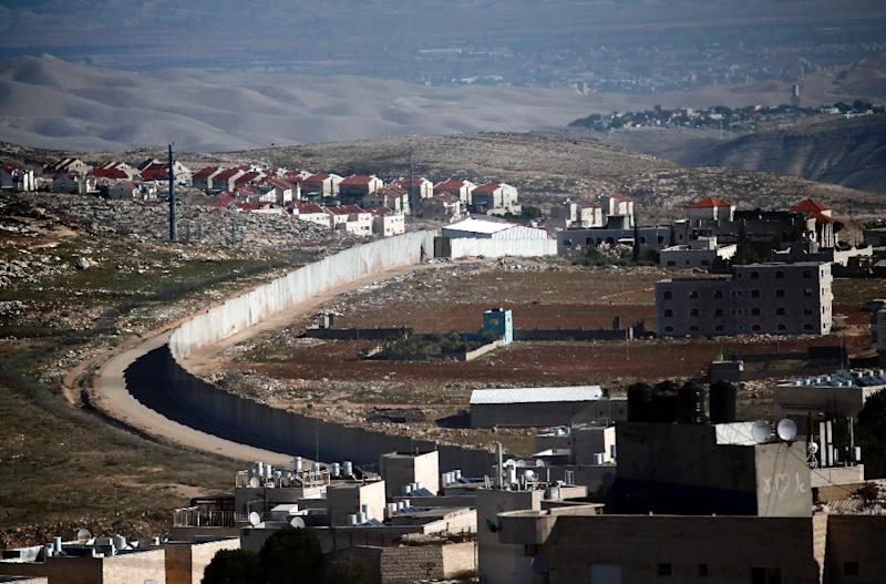 A section of Israel's separation barrier in east Jerusalem divides the Palestinian Shuafat refugee camp (right) from the Jewish settlement Pisgat Zeev (AFP Photo/Thomas Coex)