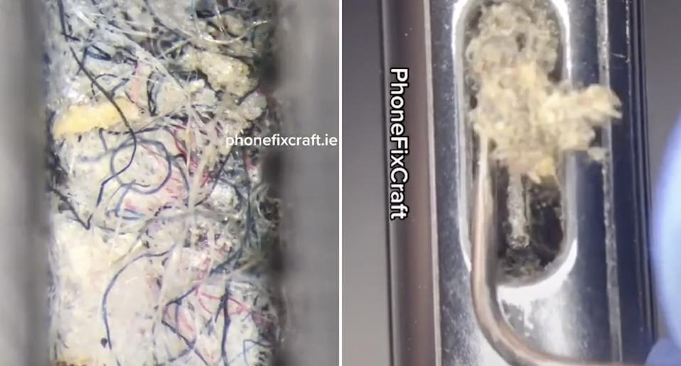 The charger port of an iPhone is pictured being cleaned with lint, hair and dirt removed.