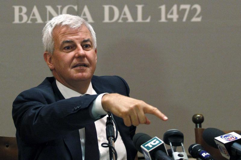Banca Monte dei Paschi di Siena's newly appointed Chairman Profumo gestures during a news conference at the company's headquarters in Siena
