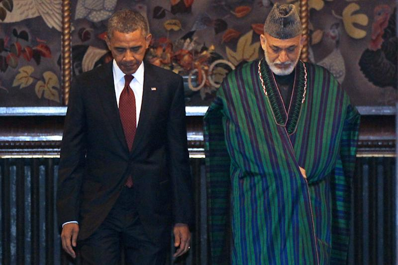 President Barack Obama and Afghan President Hamid Karzai emerge from their meeting before signing a strategic partnership agreement at the presidential palace in Kabul, Afghanistan, Wednesday, May 2, 2012. (AP Photo/Charles Dharapak)
