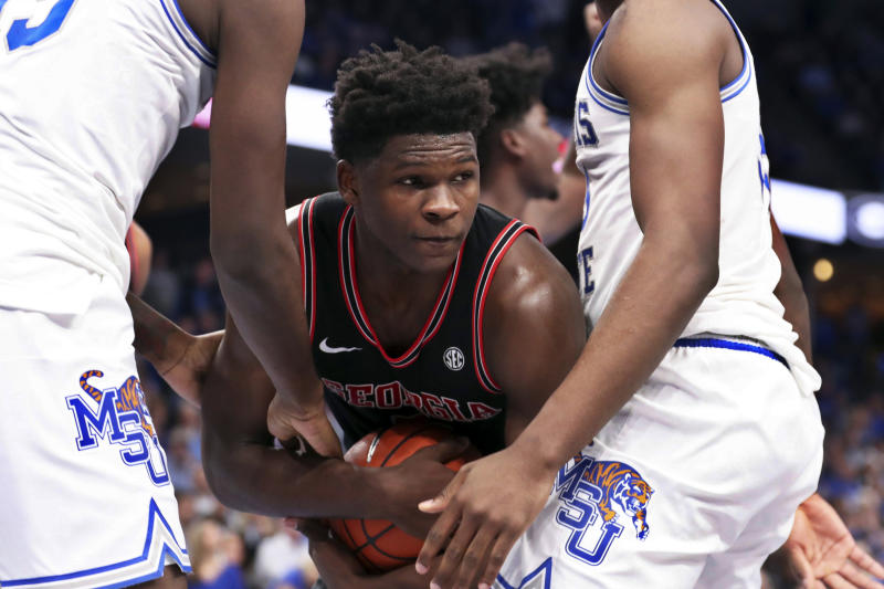 Georgia guard Anthony Edwards ( 5 ) grabs a rebound in the first half of an NCAA college basketball game against Memphis, Saturday, Jan. 4, 2020, in Memphis, Tenn. (AP Photo/Karen Pulfer Focht)