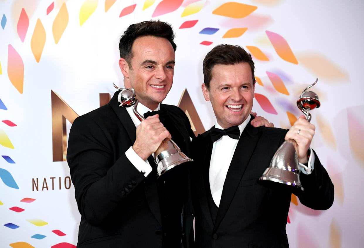 Anthony McPartlin (left) and Declan Donnelly with the awards for best TV presenter and best entertainment programme in the Press Room at the National Television Awards 2020 held at the O2 Arena, London. Photo credit should read: Doug Peters/EMPICS