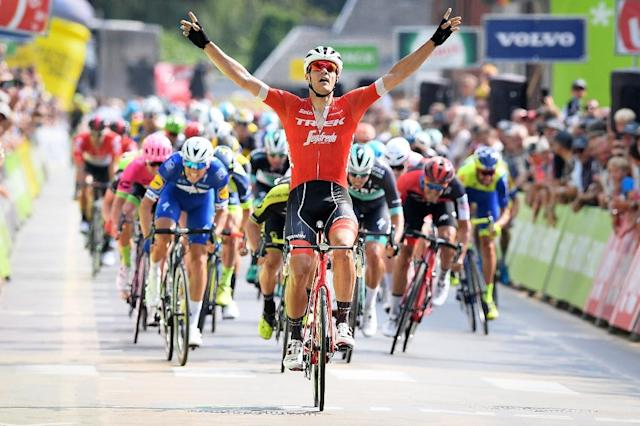 Time to celebrate: Belgian Jasper Stuyven crosses the finish line (AFP Photo/DAVID STOCKMAN)