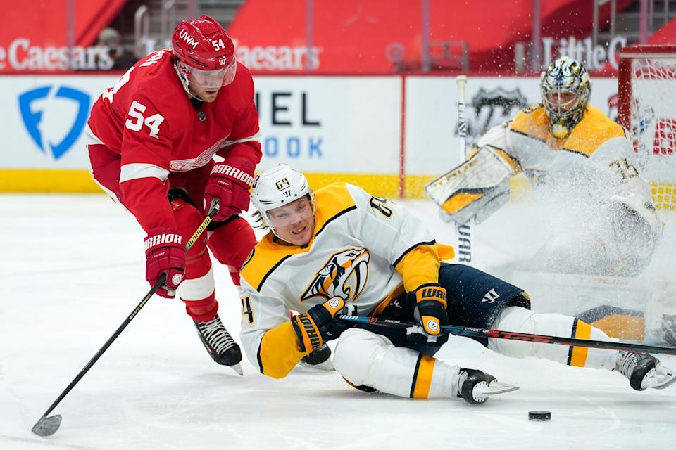 Predators center Mikael Granlund loses his edge as Red Wings right wing Bobby Ryan defends in the second period on Thursday, Feb. 25, 2021, at Little Caesars Arena.