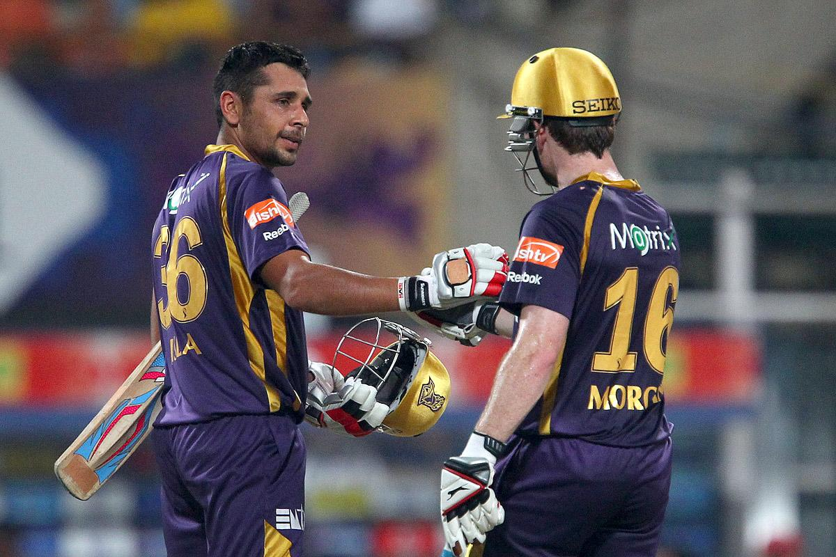 Manvinder Bisla celebrates his fifty with Eoin Morgan during match 35 of the Pepsi Indian Premier League between The Kolkata Knight Riders and the Kings XI Punjab held at the Eden Gardens Stadium in Kolkata on the 26th April 2013. (BCCI)