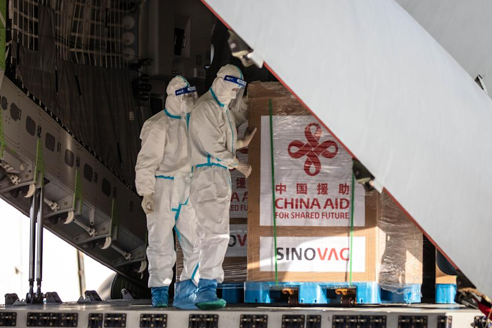 MANILA, PHILIPPINES - FEBRUARY 28: Crates containing Sinovac Biotech COVID-19 vaccines are unloaded from a Chinese Airforce plane upon arriving at Ninoy Aquino International Airport on February 28, 2021 in Manila, Philippines. Philippine President Rodrigo Duterte witnessed the arrival of 600,000 doses of Sinovac Biotech vaccines donated by the Chinese government. Sunday's delivery marks the first time the Philippines received official coronavirus vaccines, the last country in ASEAN to do so. Government officials in the country faced backlash after admitting to receiving doses of smuggled vaccines as early as October of last year. (Photo by Ezra Acayan/Getty Images)