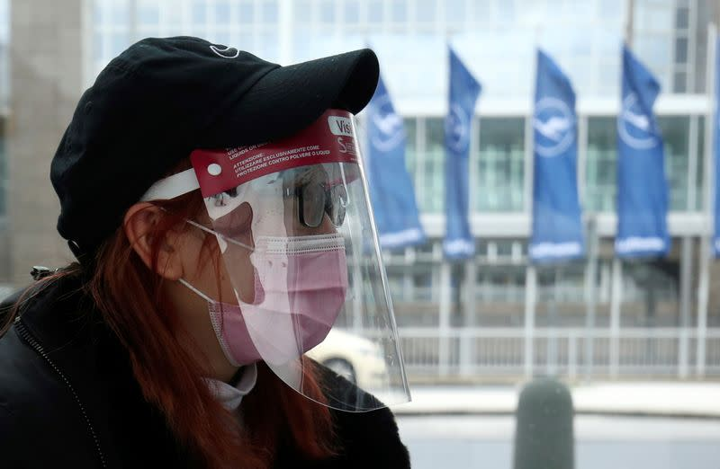 Flight passenger wears a protective mask at Frankfurt Airport