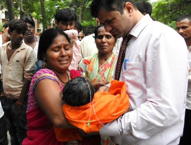 This file photo taken on August 12, 2017 shows relatives mourning the death of a child at the Baba Raghav Das Hospital in Gorakhpur, in the northern Indian state of Uttar Pradesh