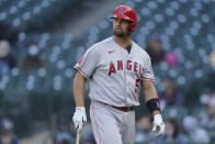 Los Angeles Angels Albert Pujols walks to the dugout after he was called out on strikes during the ninth inning of a baseball game against the Seattle Mariners, Sunday, May 2, 2021, in Seattle. (AP Photo/Ted S. Warren)