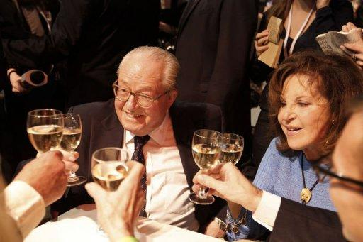 European MP and former leader of French far right party Front National (FN) Jean-Marie Le Pen (L) and his wife Jany share a toast with supporters during the Election night rally of his party to support FN's candidate Marine Le Pen on the evening of the first round of the 2012 French Presidential election in Paris. Far-right candidate Marine Le Pen won 18.2 to 20 percent in Sunday's first-round
