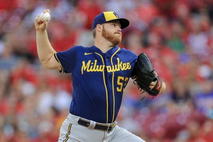 Milwaukee Brewers' Brandon Woodruff throws during the first inning of the team's baseball game against the Cincinnati Reds in Cincinnati, Saturday, July 17, 2021. (AP Photo/Aaron Doster)