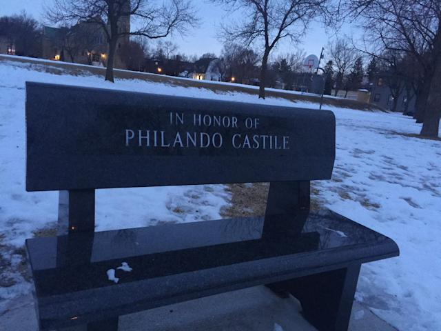 There is a bench memorial outside the school where Philando Castile worked. (Yahoo Sports)