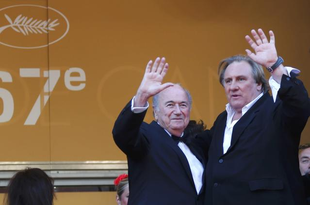 """Actor Gerard Depardieu (R) and FIFA President Sepp Blatter pose on the red carpet for the screening of the film """"United Passions"""" at the 67th Cannes Film Festival in Cannes May 18, 2014. REUTERS/Yves Herman (FRANCE - Tags: ENTERTAINMENT)"""