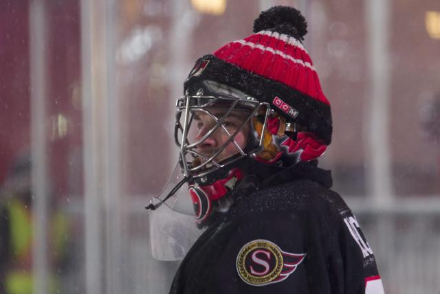 <p>Former Ottawa Senators goaltender Pascal Leclaire rocks the classic Jose Theodore-inspired, toque-over-the-helmet look during Friday's alumni game. </p>