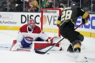 Montreal Canadiens goaltender Carey Price (31) blocks a shot by Vegas Golden Knights left wing William Carrier (28) during the second period in Game 1 of an NHL hockey Stanley Cup semifinal playoff series Monday, June 14, 2021, in Las Vegas. (AP Photo/John Locher)