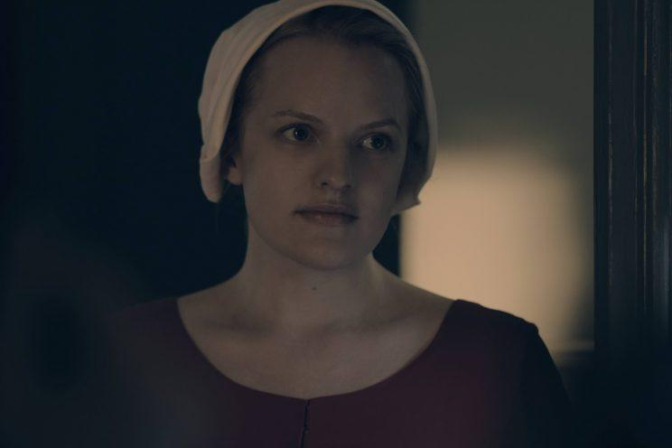 Elisabeth Moss as Offred.