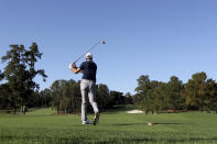 Dustin Johnson tees off on the 8th hole during the second round of the Masters Friday, Nov. 13, 2020, in Augusta, Ga. (Curtis Compton/Atlanta Journal-Constitution via AP)
