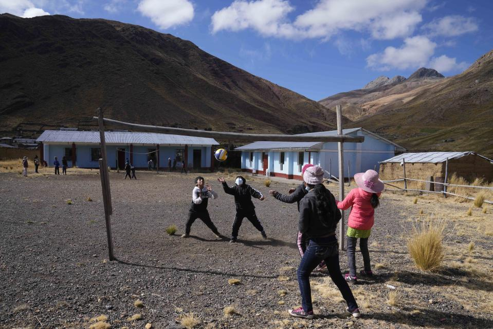 Students play volleyball during recess at a bilingual public primary school in Licapa, Peru, Wednesday, Sept. 1, 2021. In 1975, a nationalist military government turned Quechua into an official language in Peru, along with Spanish, but legal recognition did not stop discrimination against Quechua speakers, who come mostly from poor and rural areas. (AP Photo/Martin Mejia)