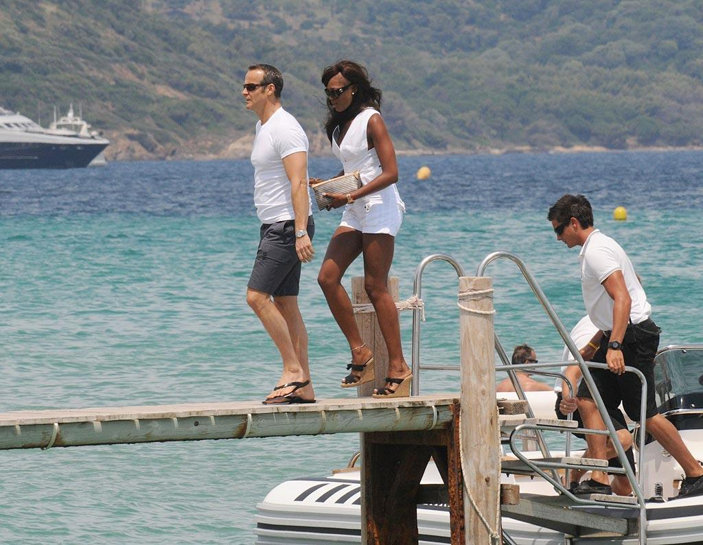 """Supermodel Naomi Campbell worked it on a different kind of runway than she's used to -- a pier -- while in St. Tropez with boyfriend Vladimir Doronin. <a href=""""http://www.infdaily.com"""" target=""""new"""">INFDaily.com</a> - July 3, 2010"""