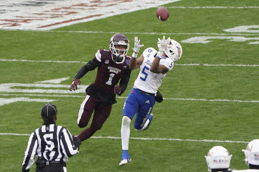 Tulsa wide receiver JuanCarlos Santana (5) catches the ball in front of Mississippi State cornerback Martin Emerson (1) during the first half of the Armed Forces Bowl NCAA college football game Thursday, Dec. 31, 2020, in Fort Worth, Texas. (AP Photo/Jim Cowsert)