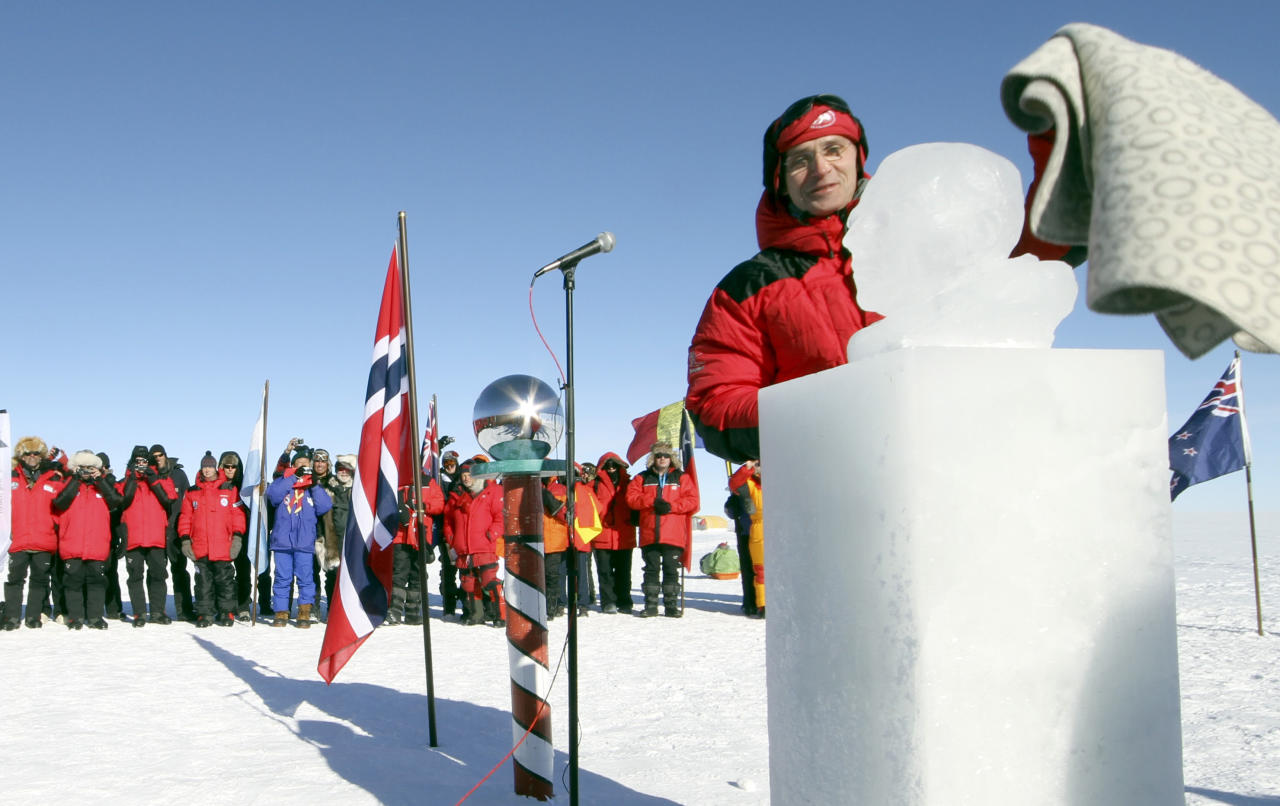 Norway`s Prime Minister Jens Stoltenberg unveils an ice sculpture of polar explorer Roald Amundsen on the South Pole, Wednesday Dec. 14, 2011. Amundsen and his team became the first men to reach the South Pole on December 14, 1911. (AP Photo/Ole Mathismoen/Pool) NORWAY OUT
