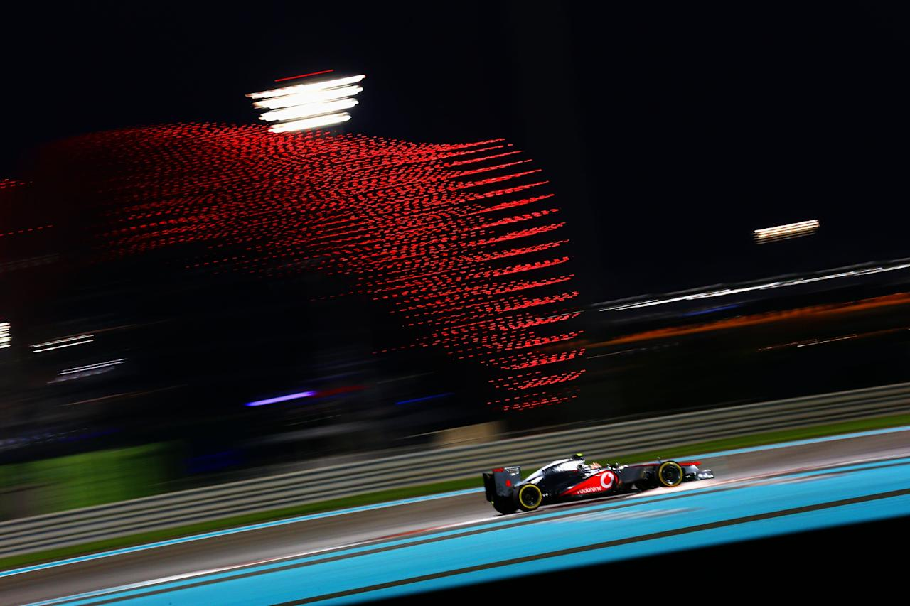 ABU DHABI, UNITED ARAB EMIRATES - NOVEMBER 03:  Lewis Hamilton of Great Britain and McLaren drives on his way to finishing first during qualifying for the Abu Dhabi Formula One Grand Prix at the Yas Marina Circuit on November 3, 2012 in Abu Dhabi, United Arab Emirates.  (Photo by Paul Gilham/Getty Images)