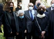 Family members of Lokman Slim, a Shi'ite publisher and activist, are pictured during a gathering to pay tribute to him, one week after he was found dead in his car, in Beirut