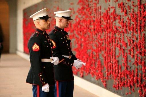 US Marines stand at the Australian War Memorial Roll of Honour before the arrival of US President Barack Obama in Canberra. President Barack Obama has signalled a pivotal US shift to Asia, pledging not to let Washington's budget crunch compromise his expansive vision and military presence in the region