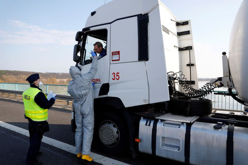 Truck driver gets a temperature check on the German-Polish border in Frankfurt/Oder