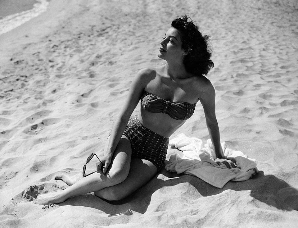 <p>Ava Gardner soaks up the sun while shooting <em>Pandora and the Flying Dutchman </em>in 1951.</p>