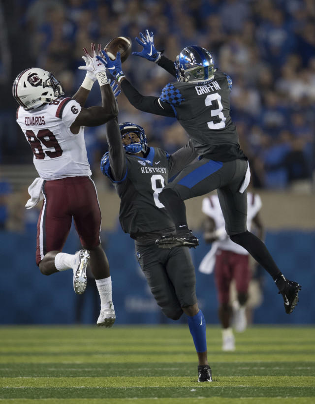 Kentucky safety Jordan Griffin and cornerback Derrick Baity Jr. (8) break up the pass to South Carolina wide receiver Bryan Edwards (89) during the first half of an NCAA college football game in Lexington, Ky., Saturday, Sept. 29, 2018. (AP Photo/Bryan Woolston)