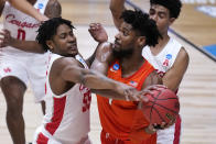 Houston forward Brison Gresham (55) defends Syracuse forward Quincy Guerrier (1) in the second half of a Sweet 16 game in the NCAA men's college basketball tournament at Hinkle Fieldhouse in Indianapolis, Saturday, March 27, 2021. (AP Photo/Michael Conroy)