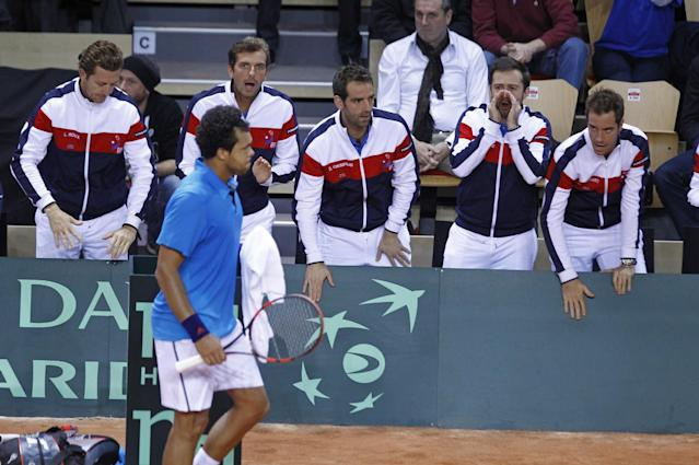 France's Jo-Wilfried Tsonga, foreground, gets encouragements from teammates, during his single match against Australia's Lleyton Hewitt, in the first round of the Davis Cup between France and Australia, in La Roche sur Yon, western France, Friday Jan. 31, 2014. France leads 2-0 at the end of the first day.(AP Photo/Remy de la Mauviniere)