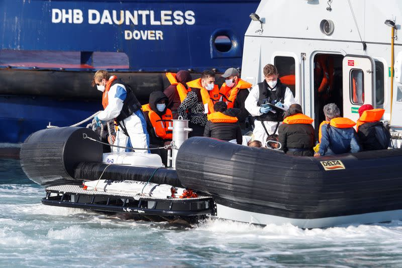 A Border Force boat carrying migrants arrives at Dover harbour, in Dover