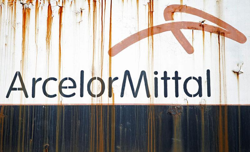 FILE PHOTO: Steel factory ArcelorMittal's logo is seen on an old train in Zenica