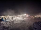 Rescuers take part in a search operation after an avalanche hit a ski resort in Norilsk