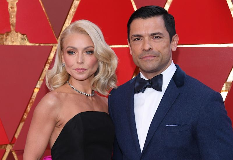 Kelly Ripa and Mark Consuelos pose at an event