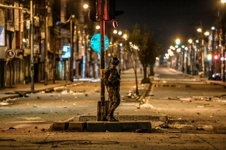 A Colombian soldier guards a street in Bogota's Patio Bonito neighborhood after November 2019 protests