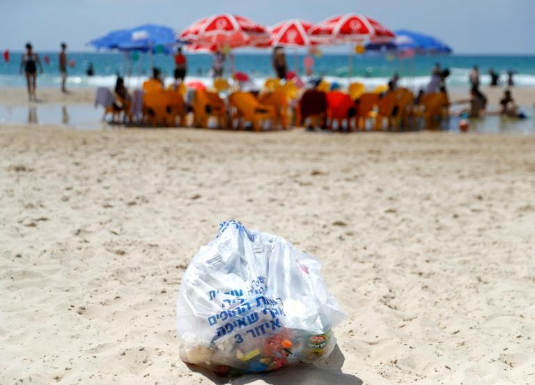 Environmental groups are trying to clean up the plastic on Israel's beaches but face a battle to break habits (AFP Photo/JACK GUEZ)