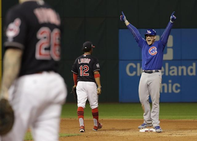 <p>Chicago Cubs' Anthony Rizzo reacts after teammate Kris Bryant scored on Rizzo's hit during the fifth inning of Game 7 of the Major League Baseball World Series against the Cleveland Indians Wednesday, Nov. 2, 2016, in Cleveland. (AP Photo/David J. Phillip) </p>