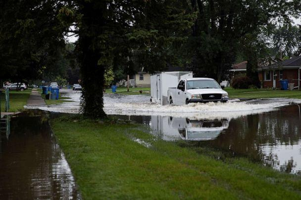 PHOTO: A truck makes its way through Edgewood Street which flooded as a result of heavy rain in Dearborn Heights, Michigan, July 17, 2021. (Emily Elconin/Reuters)
