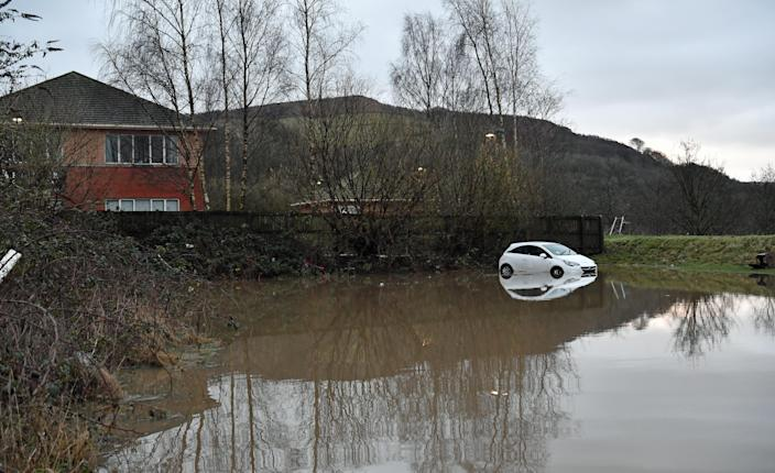 A car washed away in Nantgarw, south Wales, by Storm Dennis. (PA Images via Getty Images)