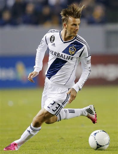 Los Angeles Galaxy's David Beckham, of England, looks to pass the ball in the first half of an MLS playoff soccer match against the Vancouver Whitecaps in Carson, Calif., Thursday, Nov. 1, 2012. (AP Photo/Jae C. Hong)